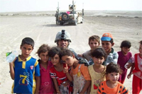 Iraqi children surround Army Staff Sgt. Danillo Martinez after singing an Arabic song in Harbi Village, Iraq, Nov. 1, 2009. U.S. Army photo by Pfc. Ronald Leydet