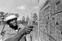 Then- Staff Sgt. Leon E. Caffie points to a hit during Army Reserve training in Florida in the 1970s