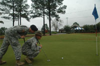 James Gilbert, left, and Larry Jackson try to gauge a putt at the Fort Jackson Golf Club.